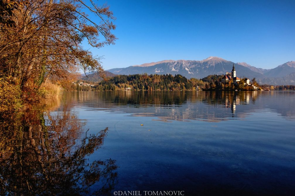 Lake Bled in autumn with the Karavanke mountain chain in the background