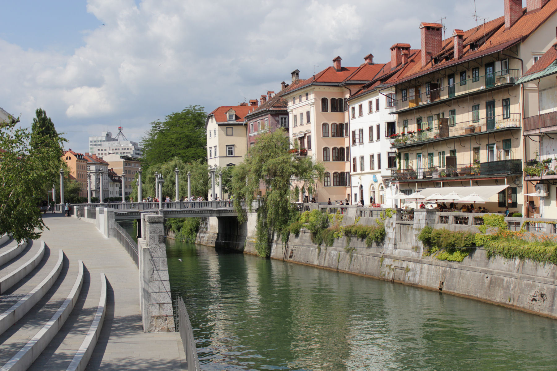 The Ljubljanica River, lined with cafés and restaurants meanders through the town center