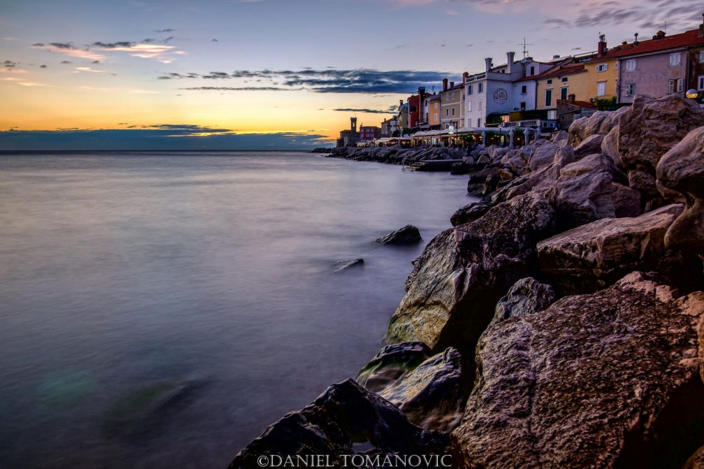 A view of the rocky waterfront in Piran, Slovenia