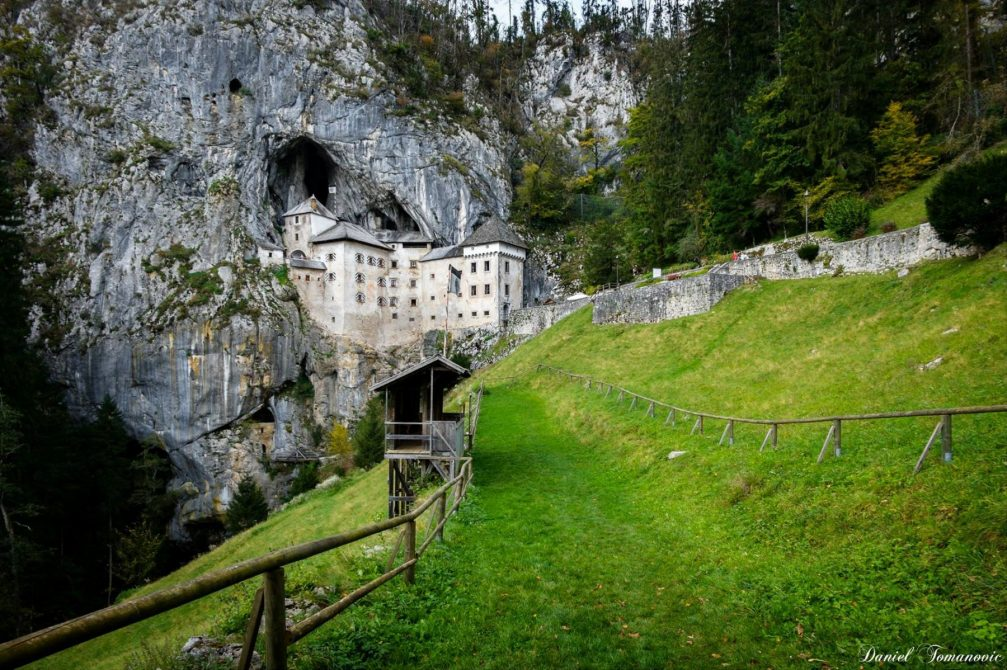 A view of the Predjama Castle built into the mouth of a cave