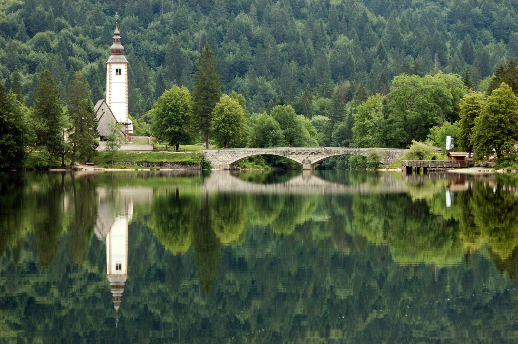 A view on Lake Bohinj and the church of St John the Baptist in Ribcev Laz
