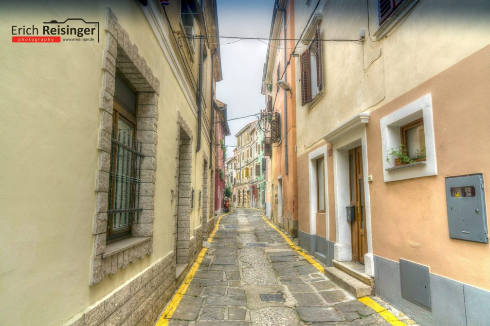 A narrow street in the old part of the town of Izola, Slovenia