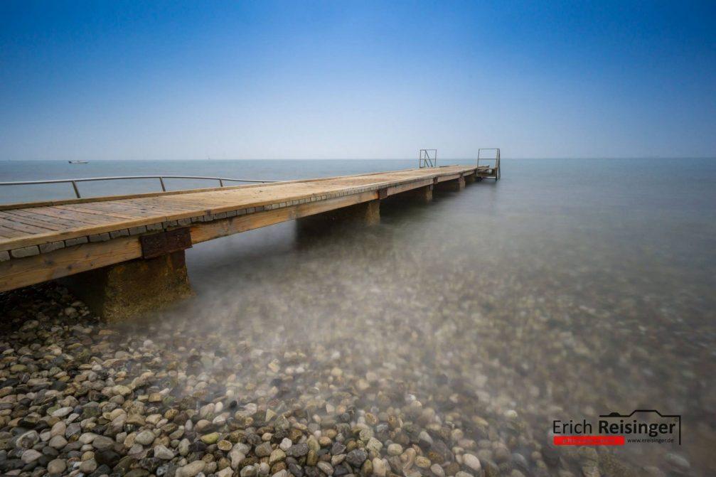 A wooden dock in the Adriatic Sea in Izola, Slovenia