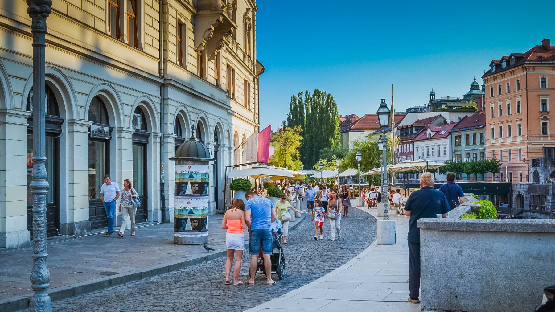 Take a walk alongside the Ljubljana River with restaurants, cafés and shops