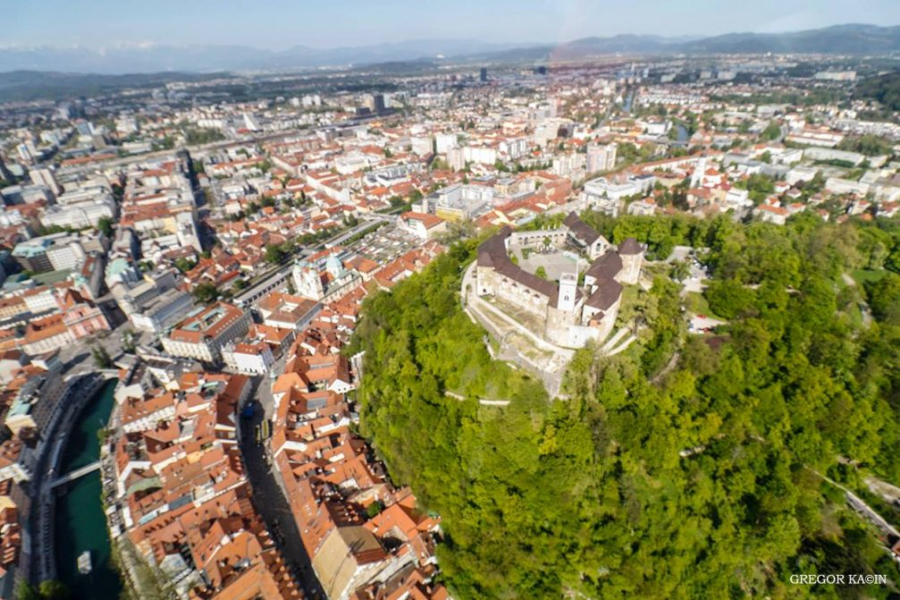 Aerial view of Slovenia's capital Ljubljana and the castle from an airplane