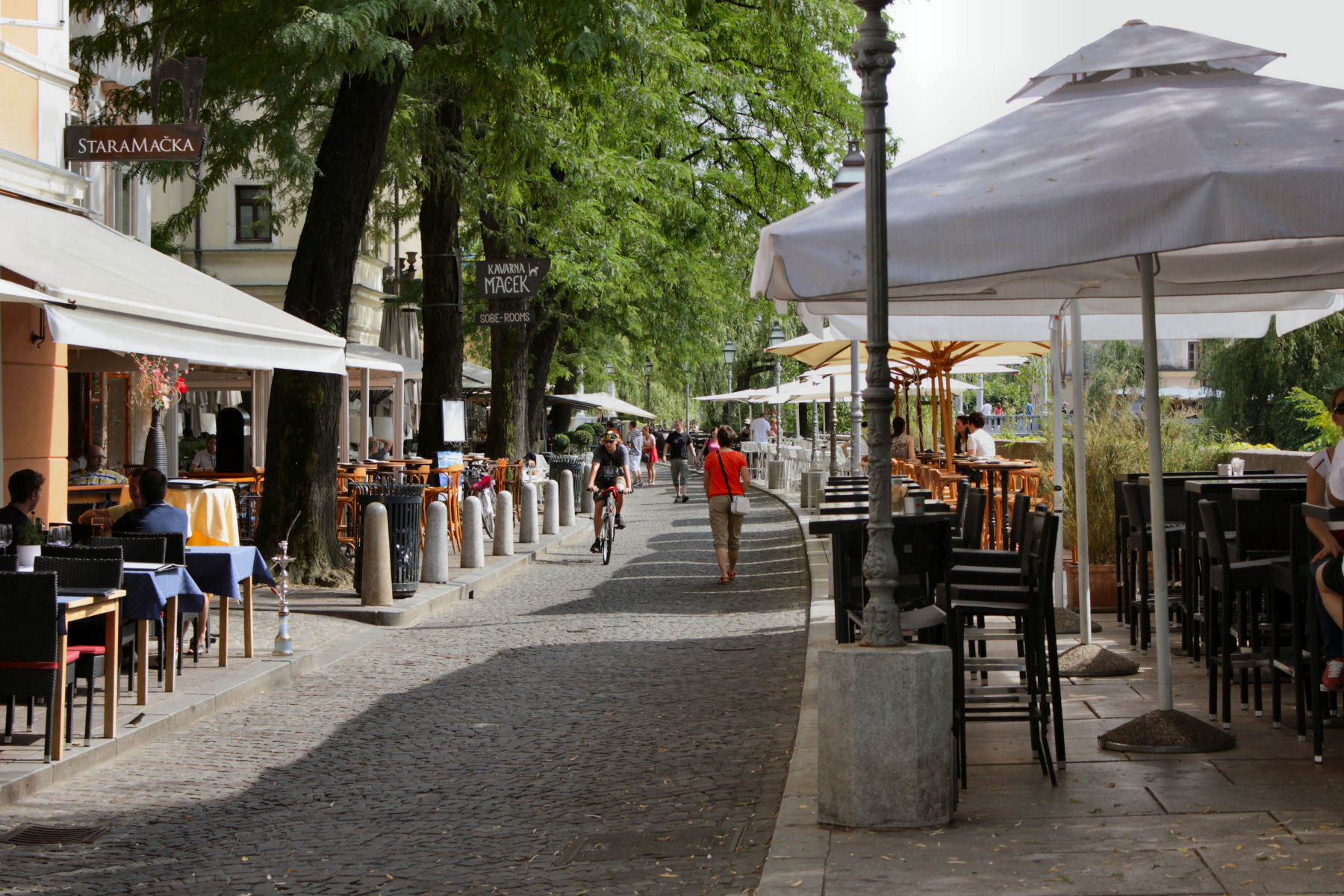 A couple of the many cafes and bars along the Ljubljanica riverbanks in Ljubljana, Slovenia