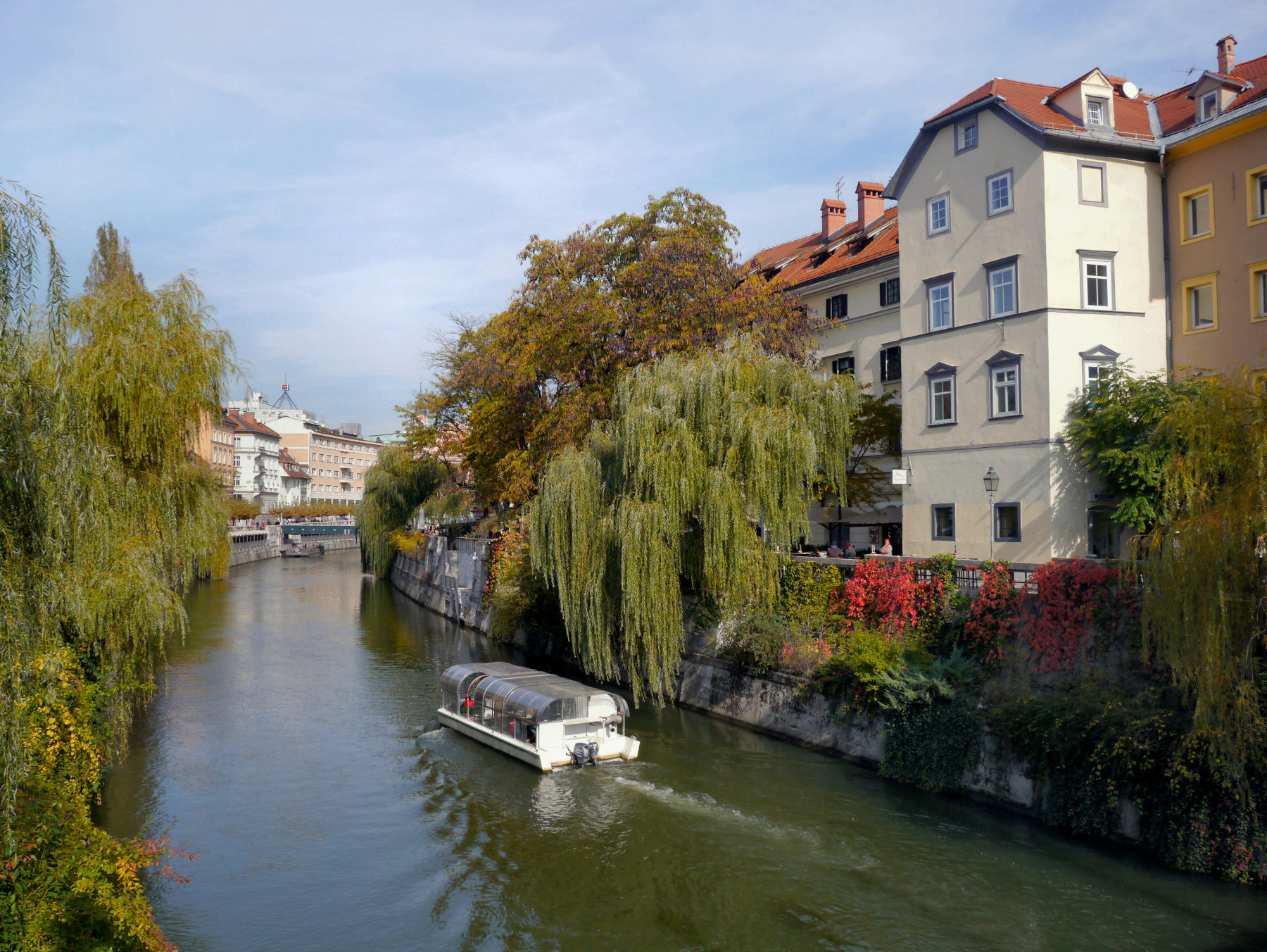One of the many interesting boats cruising along the Ljubljanica river in Ljubljana Old Town, Slovenia
