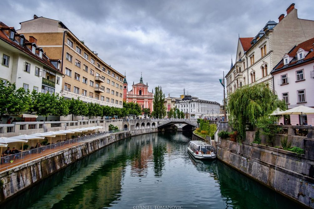 The Ljubljanica River flowing through Ljubljana's Old Town in the summer