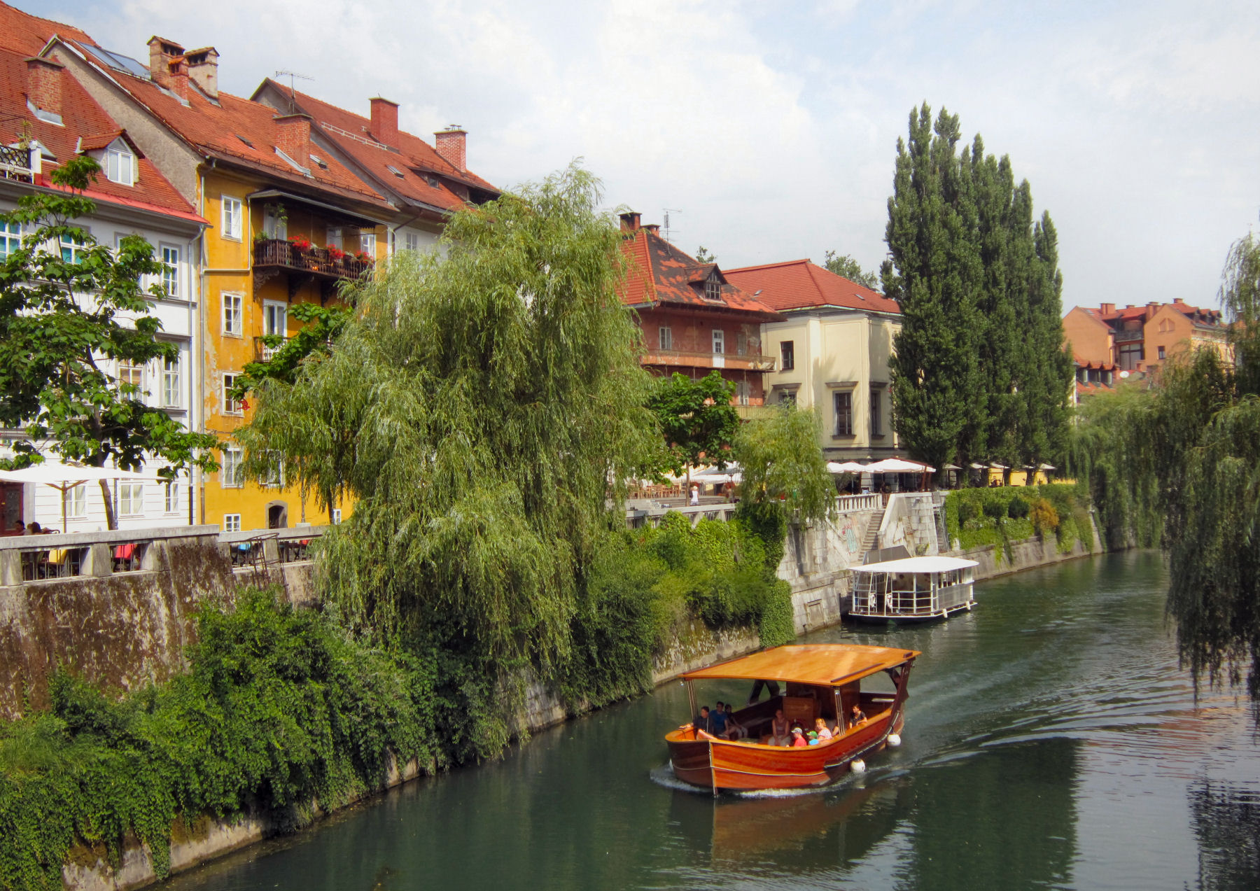 Tourist boats on the Ljubljanica river in Slovenia's capital city Ljubljana