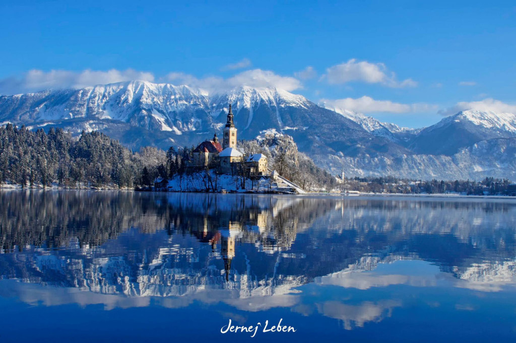 Bled Island in the middle of Lake Bled covered in snow in winter
