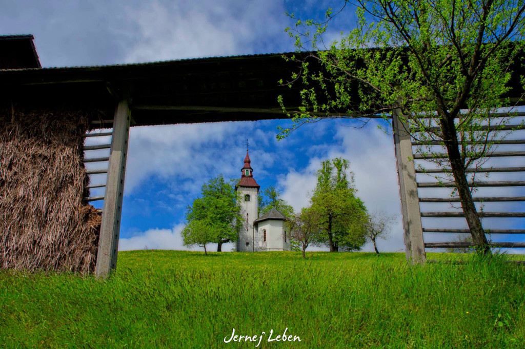 Hayracks and churches are a distinct feature of the Slovenian landscape