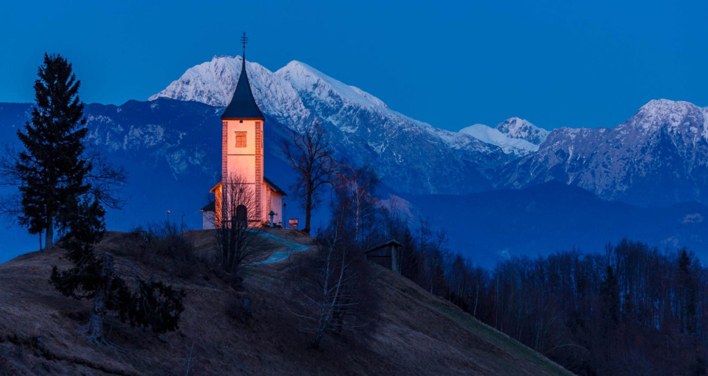 Jamnik church of Saints Primus and Felician illuminated at night, Slovenia