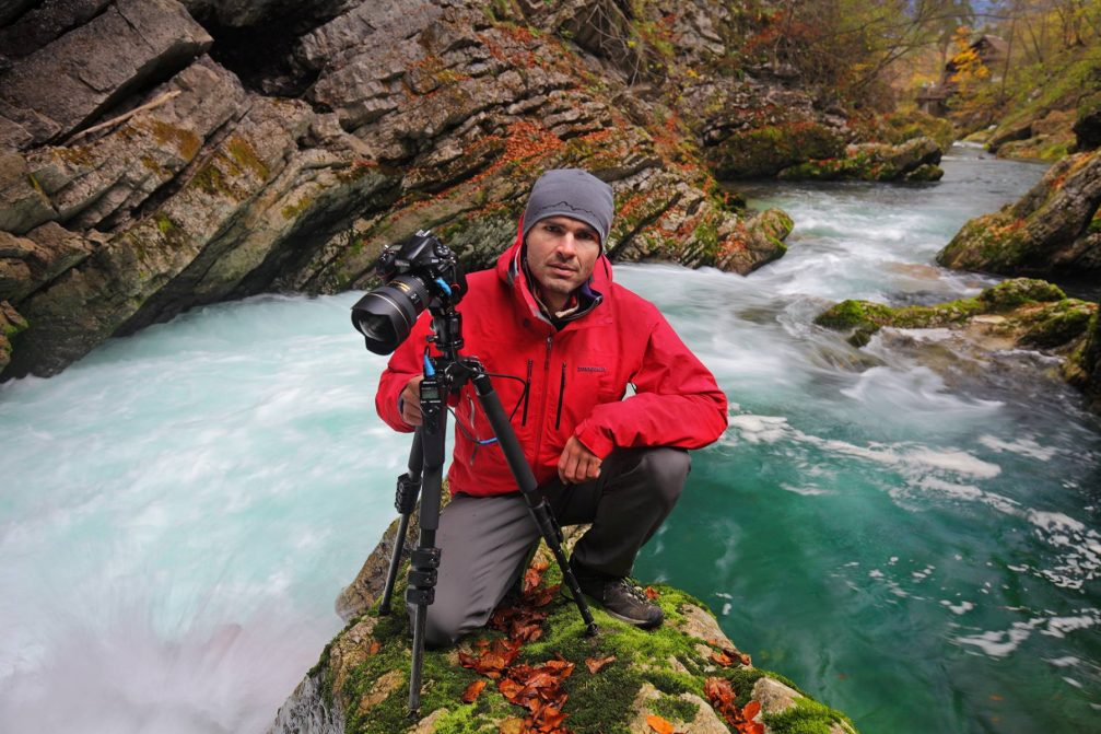 Slovenian landscape photographer Luka Esenko posing with his camera