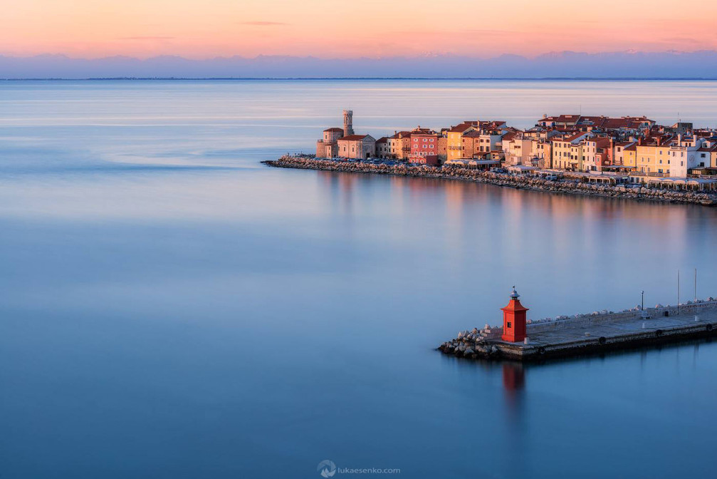 The charming coastal town of Piran basking in the evening light