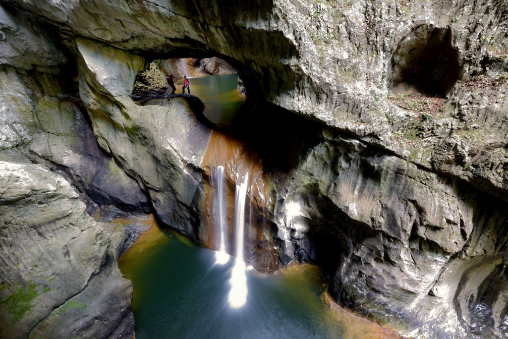 Waterfalls of the Reka river in the collapsed doline, before the river enters the underground canyon of Skocjan caves
