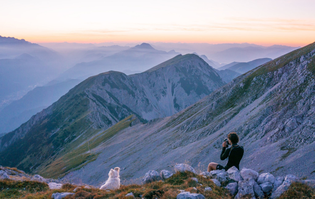 The Slovenian landscape photographer Ales Krivec at work, focusing on a sunset in the Alps