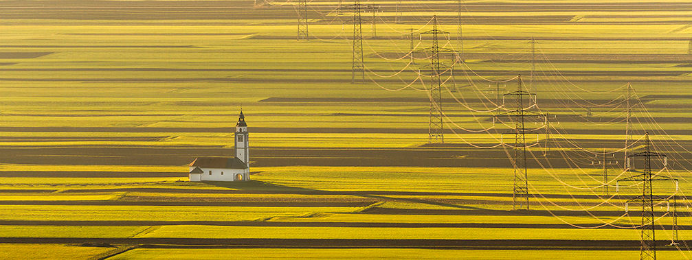 Church of St. Ursula in the middle of the Sorsko Polje fields, near Srednje Bitnje, Slovenia