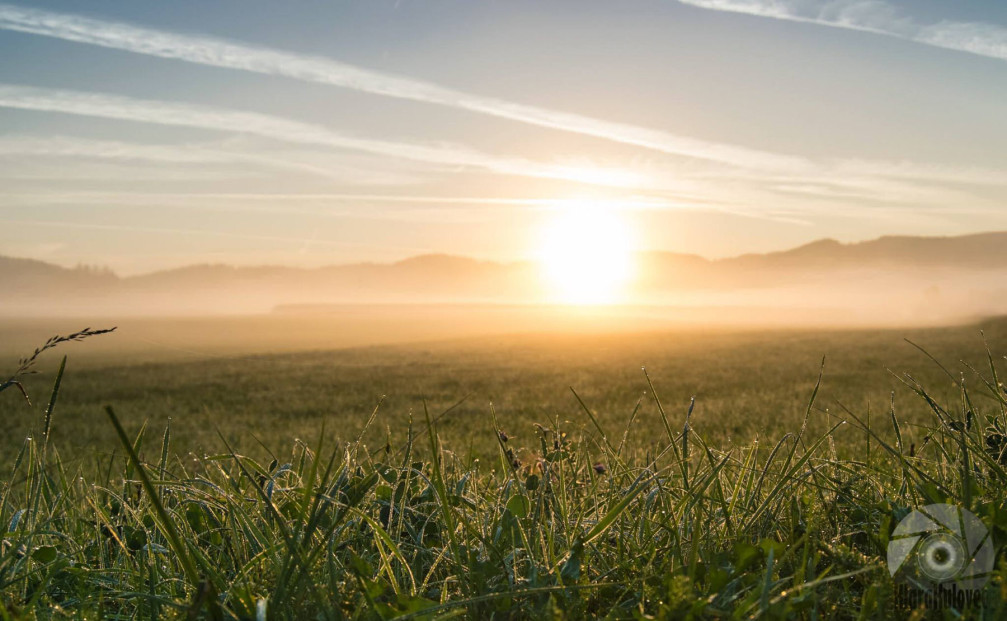 Sunrise on foggy morning in the Slovenian countryside