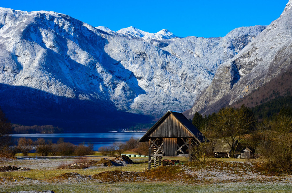 Double hayrack with the Bohinj lake in the background, Slovenia