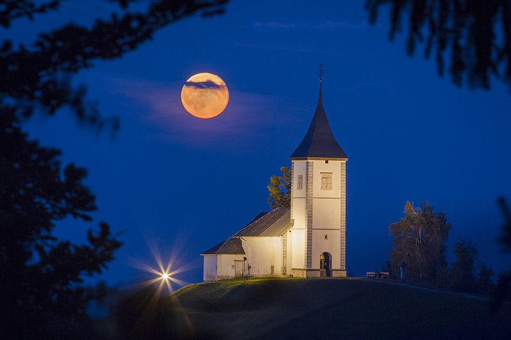Jamnik Church of Saints Primus and Felician at night in the moonlight, Slovenia
