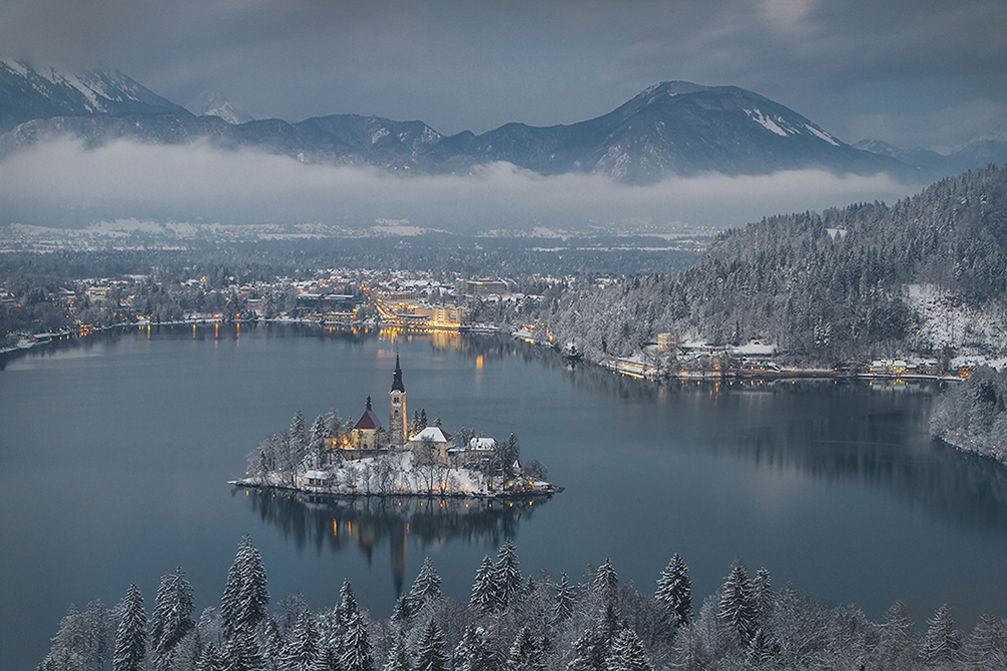 Stunning view of Lake Bled, Slovenia in winter with snow