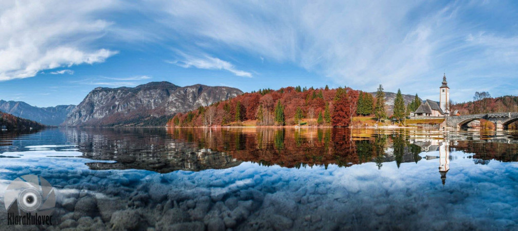 Lake Bohinj, Slovenia in autumn with the Church of St. John the Baptist in the background