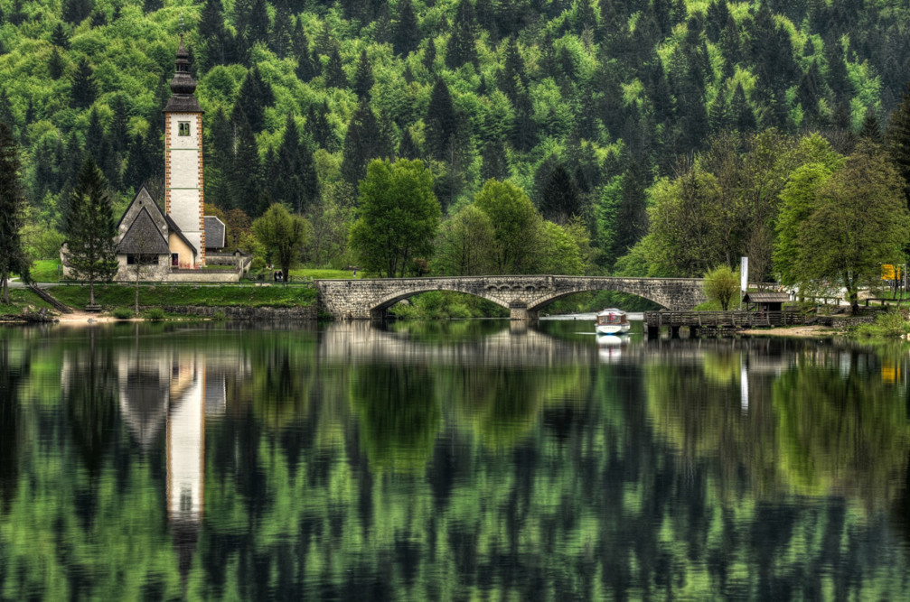 Lake Bohinj with the bridge and the medieval Church of St. John the Baptist