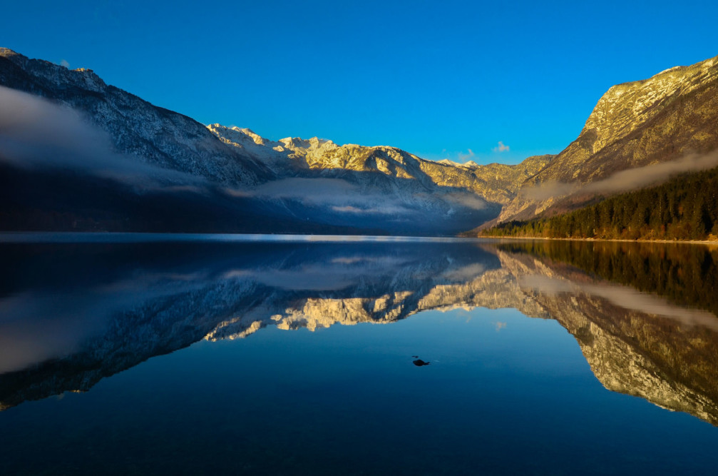 Lake Bohinj, Slovenia is famous for the still water and perfect reflection