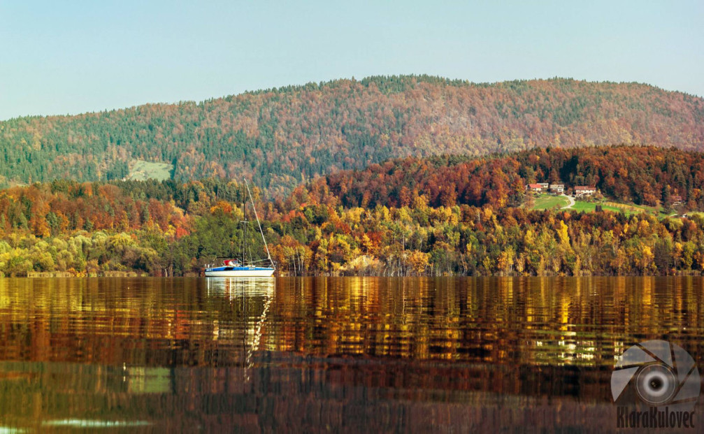 Sailboat in Lake Velenje, Slovenia in autumn