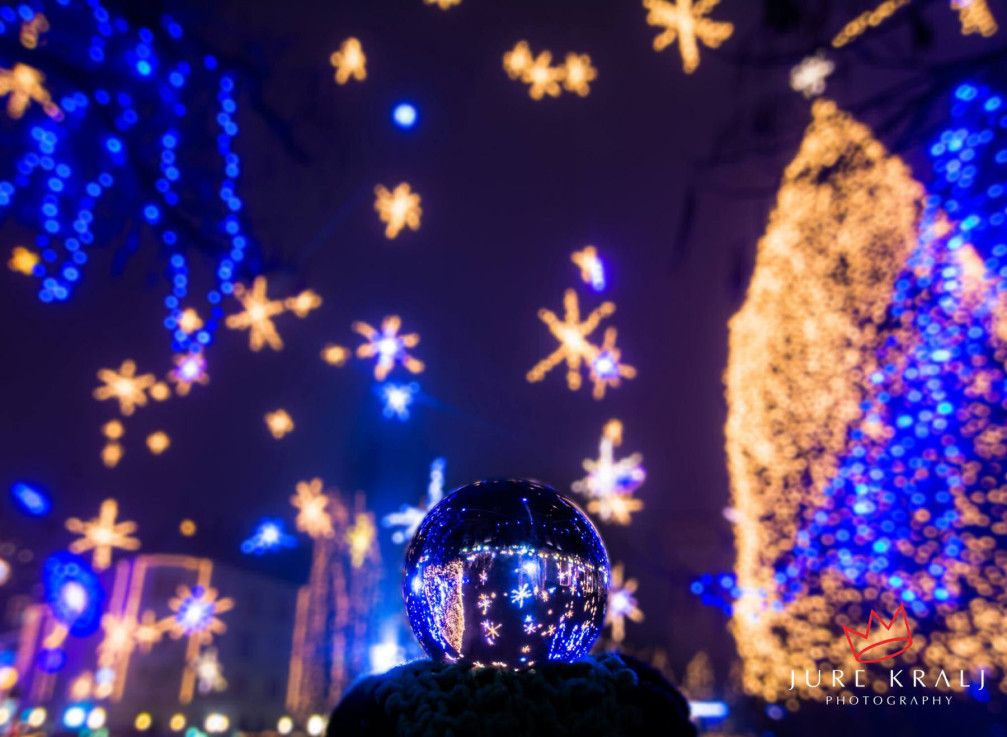 Christmas lights in Slovenia's capital Ljubljana celebrate science with geometric forms, math equations, galaxies, and planets
