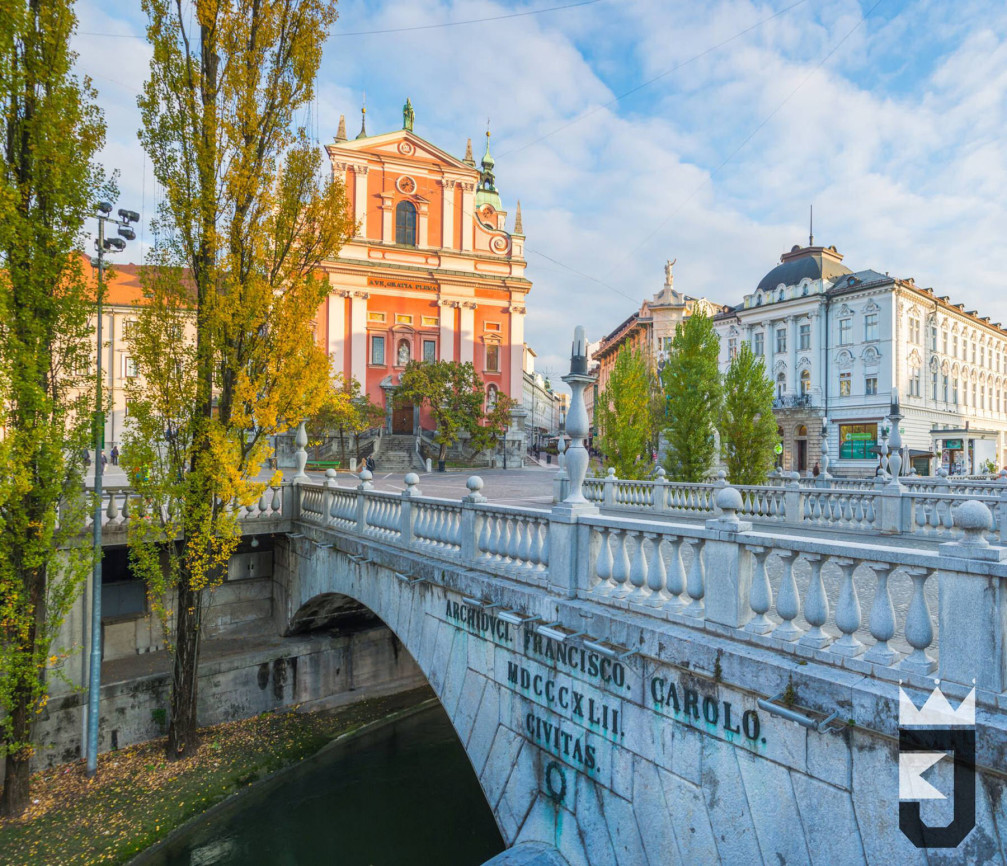 Triple Bridge in Ljubljana, the capital of Slovenia with the pink Franciscan church in the background