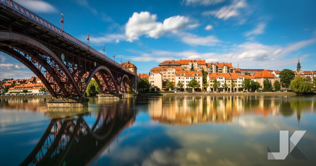 Lent and Old Bridge across the Drava river on sunny summer day, Maribor, Slovenia