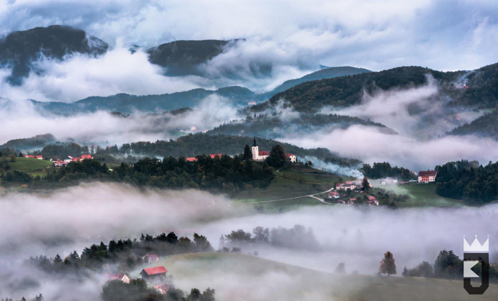 Landscape of the Loznica Hills and the Andraz nad Polzelo village with the St. Andrew's Church
