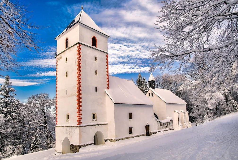 St. Wolfgang's Church stands in a clearing in the middle of Pohorje's green forests