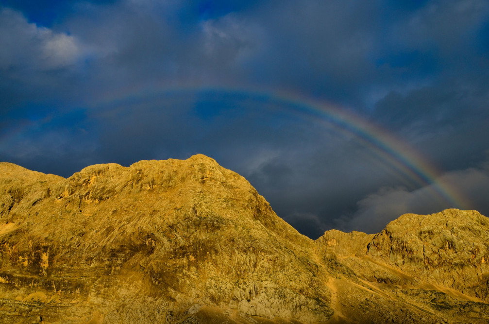 A rainbow captured by Gregor Skoberne on the Prehodavci saddle in the Julian Alps, Slovenia