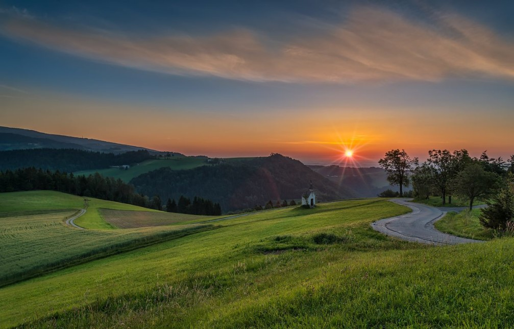 Peaceful sunrise over the chapel near the Smartno Na Pohorju village in the Pohorje Hills, Slovenia