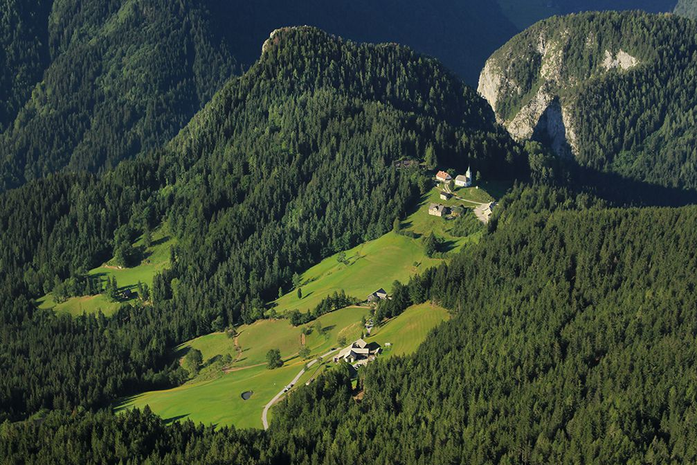 Village of Podolseva with the Church of the Holy Spirit in Slovenia