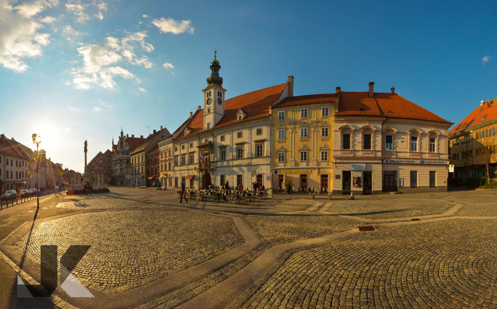 Main Square is Maribor, Slovenia, with the Plague Column monument and the Town Hall