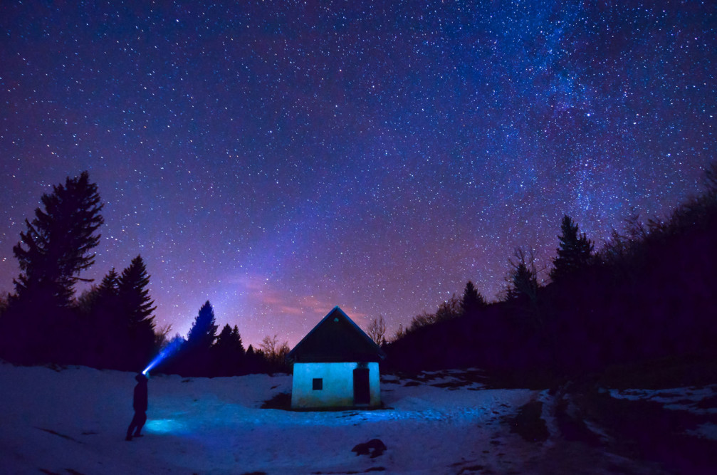 The night sky full of stars over the Vogar alpine pasture in the Bohinj area, Slovenia