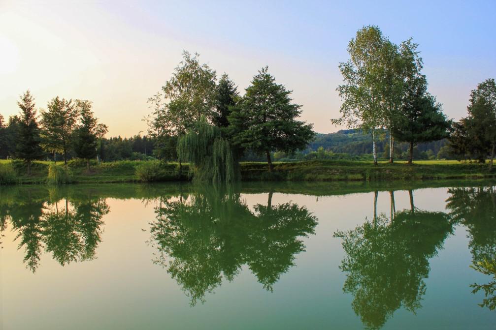 Blato Pond with beautiful reflections in calm water, Trebnje, Slovenia