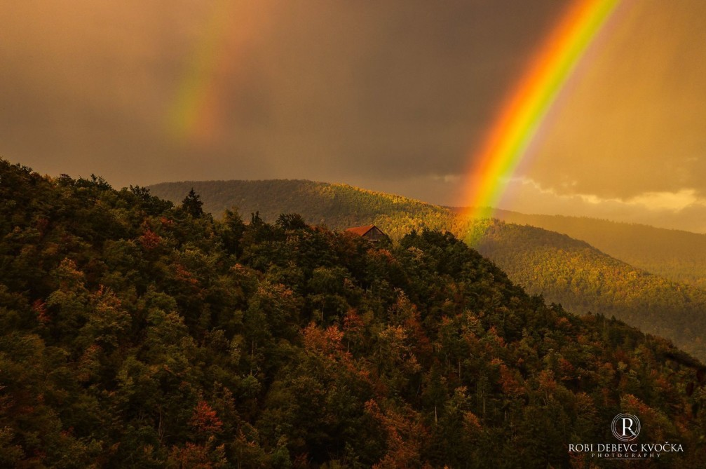 Double rainbow over the forest in the Vrhnika area in Slovenia