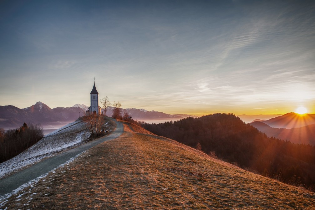 The Jamnik Church of Saints Primus and Felician and surrounding mountains of the Slovenian Alps