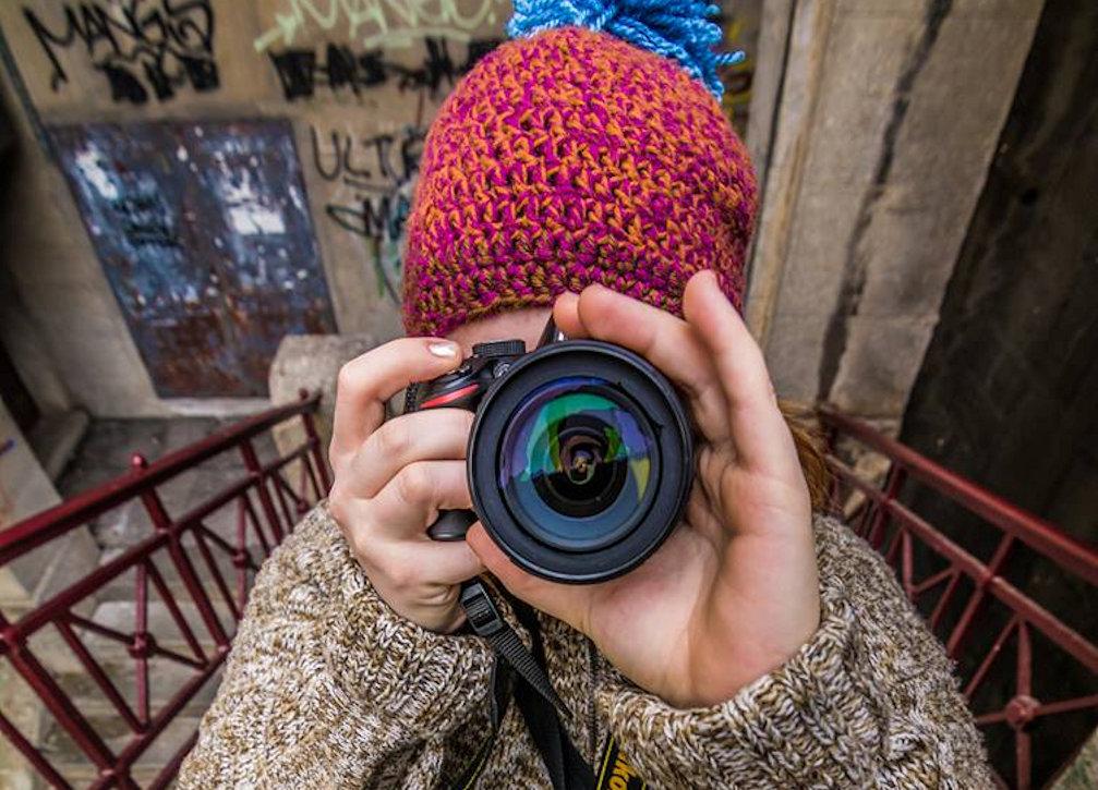Slovenian photographer Klara Kulovec with her camera in her hands