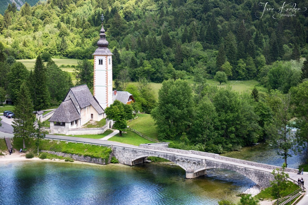 Aerial view of St John the Baptist Church and stone bridge, Lake Bohinj, Slovenia