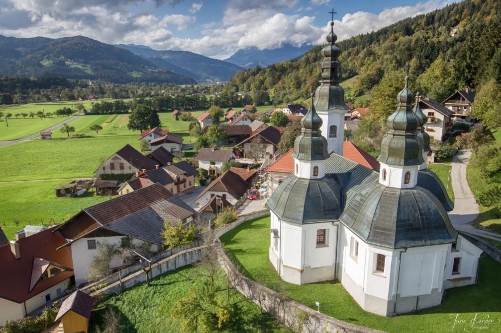 Aerial view of the village of Okonina, Slovenia with its church of St. James