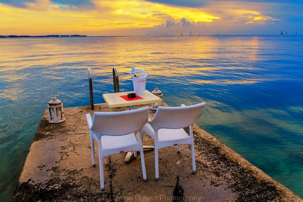 Perspective of a pier with a romantic restaurant table with an ocean view in Piran, Slovenia