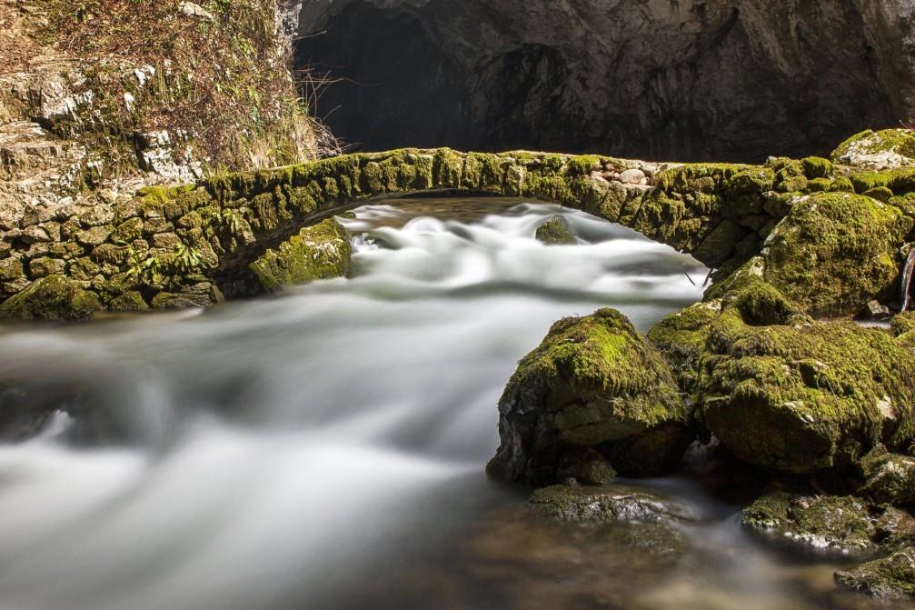 Stone bridge across Rak Creek in Rakov Skocjan in the Karst area of Slovenia