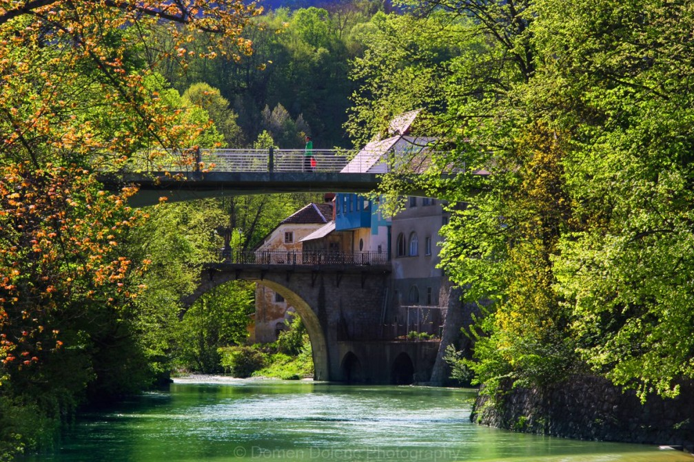 Six hundred year old stone Capuchin Bridge across the Selska Sora in Skofja Loka, Slovenia