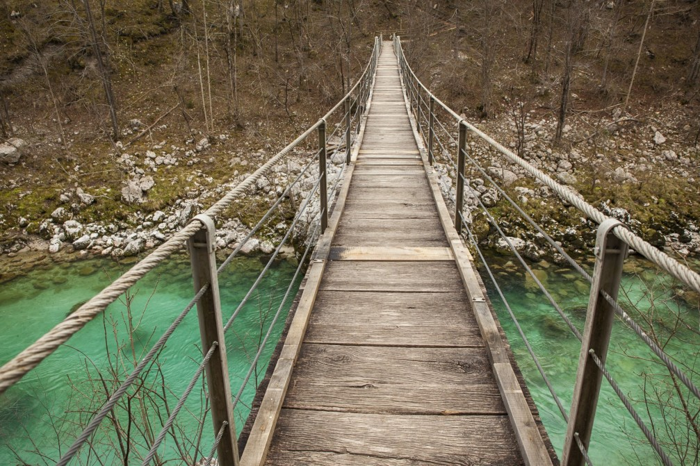Footbridge over the Soca river located near the town of Kobarid, Slovenia