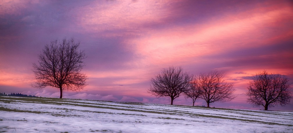 Spectacular winter sunset with vivid colors in shades of pink through purple near Velika Preska, Slovenia